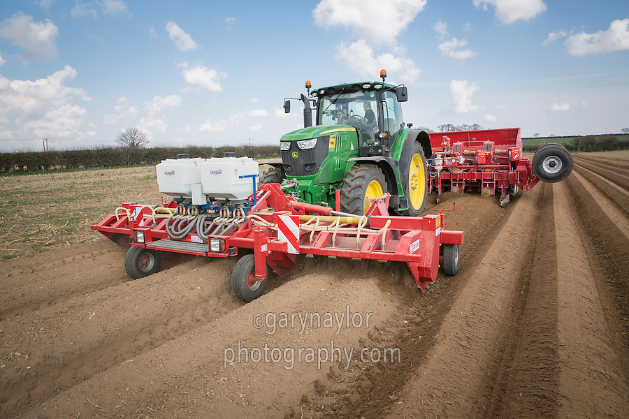 Planting potatoes with front mounted cultivator applying Vydate and planting potatoes with a six row Grimme planter - Nrofolk, March