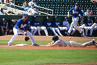 Alex Santana (21) of the Ogden Raptors on defense against the Billings Mustangs as Adam Matthews (26) of the Mustangs slides to the bag at Lindquist Field on August 18, 2013 in Ogden Utah.  (Stephen Smith/Four Seam Images)