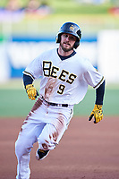Shane Robinson (9) of the Salt Lake Bees hustles to third base during the game against the El Paso Chihuahuas in Pacific Coast League action at Smith's Ballpark on May 1, 2017 in Salt Lake City, Utah.Salt Lake defeated El Paso 9-4.   (Stephen Smith/Four Seam Images)