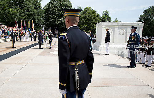 A member of the honor guard watches as United States President Barack Obama lays a wreath at the Tomb of the Unknowns during Memorial Day activities at Arlington National Cemetery in Washington on Monday, May 27, 2013..Credit: Joshua Roberts / Pool via CNP