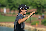 Charl Schwartzel tees off on the par3 6th tee and scores a hole in 1 during Day 1 of the Dubai World Championship, Earth Course, Jumeirah Golf Estates, Dubai, 25th November 2010..(Picture Eoin Clarke/www.golffile.ie)