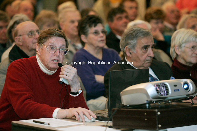 WOODBURY, CT - 14 MARCH 2005 - 031405JS07--Woodbury Selectman Charles Bartlett, left, gives a presentation on the proposed new senior center Monday during a town meeting at the Old Town Hall in Woodbury.  --Jim Shannon Photo --Charles Bartlett Old Town Hall; Woodbury are CQ