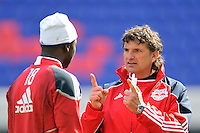 New York Red Bulls assistant coach Jan Halvor Halvorsen talks with goalkeeper Bouna Coundoul (18) during practice on Media Day at Red Bull Arena in Harrison, NJ, on March 15, 2011.