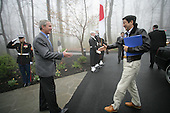 United States President George W. Bush reaches out to Prime Minister Shinzo Abe of Japan during an abbreviated arrival ceremony Friday, April 27, 2007, at Camp David, the Presidential retreat near Thurmont, Maryland..Mandatory Credit: Eric Draper / White House via CNP