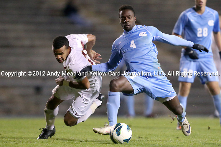 01 November 2012: UNC's Boyd Okwuonu (4) and Boston College's Stefan Carter (left). The University of North Carolina Tar Heels played the Boston College Eagles at Fetzer Field in Chapel Hill, North Carolina in a 2012 NCAA Division I Men's Soccer game. UNC defeated Boston College 4-0.