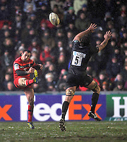 Leicester, England. Vincent Clerc of Toulouse clears the ball during the Heineken Cup match between Leicester Tigers and Toulouse at Welford Road on January  20. 2013 in Leicester, England..
