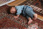 14 month old toddler boy lying on floor crying and kicking temper tantrum horizontal