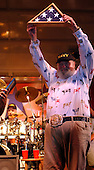 Country musician Charlie Daniels dons a Navy ballcap and waves the National  Ensign presented to him by Command Master Chief Michael Tsikours of Recruit Training Command following his performance for 11,000 recruits in training.  Daniels performed as part of the Spirit of America tour, which brings entertainers to the troops worldwide. .Mandatory Credit: Paul Roszkowski / U.S. Navy via CNP