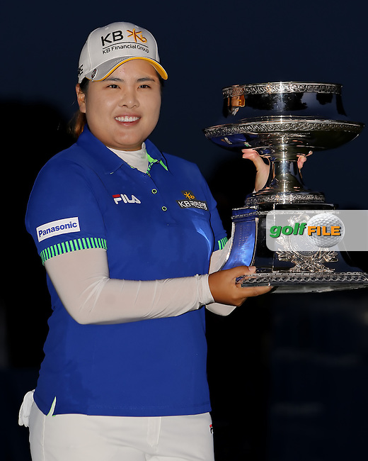 17 August 14 Korean Inbee Park celebrates on the 18th with her trophy at the conclusion of Sunday's Final Round of The Wegman's LPGA Championship at The Monroe Golf Club in Pittsford, New York. (photo credit : kenneth e. dennis/kendennisphoto.com)
