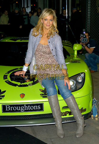 LIZ FULLER.The Gumball 3000 Miles - film premiere, KOKO, London, UK..November 30th, 2006.full length grey gray boots tucked into jeans denim leopard print op purple leather jacket sitting.CAP/CAN.©Can Nguyen/Capital Pictures