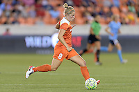 Houston, TX - Friday April 29, 2016: Ellie Brush (8) of the Houston Dash brings the ball up the field against Sky Blue FC at BBVA Compass Stadium. The Houston Dash tied Sky Blue FC 0-0.