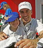 Driver Joao Barbosa nd his son at the Rolex 24 at Daytona , Daytona International Speedway, Daytona Beach, FL, January 2009.  )Photo by Brian Cleary)