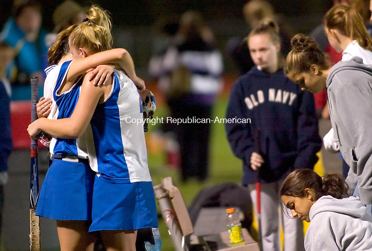 SOUTHBURY, CT- NOVEMBER 2006-111406JS02- Lewis Mills' Alex Flowers and Jen Tracy console eachother after their 1-0 loss to North Branford in the Class S field hockey semifinals Tuesday at Pomperaug High School. <br /> Jim Shannon/Republican-American