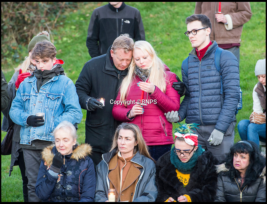 BNPS.co.uk (01202 558833)<br /> Pic: PhilYeomans/BNPS<br /> <br /> Gaia's family.<br /> <br /> The seaside town of Swanage paid its respects to tragic teenager Gaia Pope(19) at a vigil held last night.<br /> <br /> Gaia's body was found on a remote clifftop 12 days after going missing.<br /> <br /> Her family paid tribute to her and lit candles in her memory.