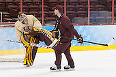 Adam Wilcox (MN - 32), Grant Potulny (MN - Assistant Coach) - The University of Minnesota Golden Gophers practiced on Wednesday, April 9, 2014, at the Wells Fargo Center in Philadelphia, Pennsylvania during the 2014 Frozen Four.