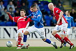 St Johnstone v Brechin...07.01.12  Scottish Cup Round 4.Marcus Haber is tackled by Paul McLean and Gerry McLauchlan.Picture by Graeme Hart..Copyright Perthshire Picture Agency.Tel: 01738 623350  Mobile: 07990 594431