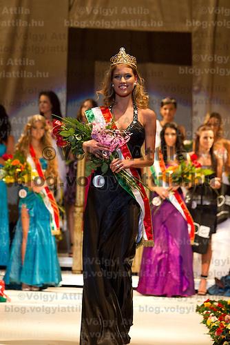 Dora Gregori (center) celebrates winning the Miss Hungary 2010 beauty contest held in Budapest, Hungary on November 29, 2010. ATTILA VOLGYI