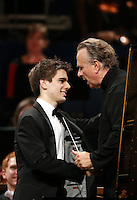 PICTURE BY VAUGHN RIDLEY/SWPIX.COM - Leeds International Piano Competition 2012 - Leeds Town Hall, Leeds, England - 15/09/12 - Andrew Tyson of USA is congratulated by Sir Mark Elder.