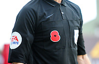 An assistant referee showing a Poppy on his shirt<br /> <br /> Photographer Andrew Vaughan/CameraSport<br /> <br /> The EFL Sky Bet League Two - Lincoln City v Forest Green Rovers - Saturday 3rd November 2018 - Sincil Bank - Lincoln<br /> <br /> World Copyright © 2018 CameraSport. All rights reserved. 43 Linden Ave. Countesthorpe. Leicester. England. LE8 5PG - Tel: +44 (0) 116 277 4147 - admin@camerasport.com - www.camerasport.com