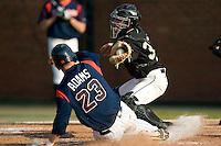 Wake Forest catcher Austin Jones blocks the plate as Virginia's David Adams (23) tries to score on a squeeze bunt at Gene Hooks Stadium in Winston-Salem, NC, Friday, March 9, 2007.  The Demon Deacons upset the #4 Cavaliers 8-3.