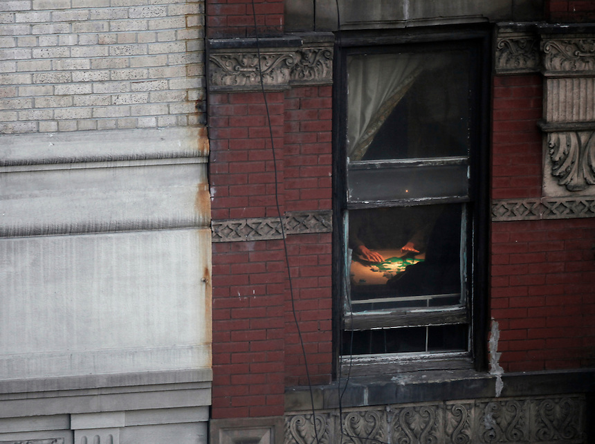 Hands are seen moving around majhong tiles in a building in Chinatown in lower Manhattan.
