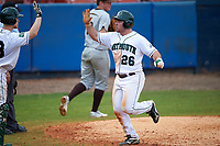 Dartmouth Big Green left fielder Ben Socher (26) high fives Rob Emery (28) during a game against the Lehigh Mountain Hawks on March 20, 2016 at Chain of Lakes Stadium in Winter Haven, Florida.  Dartmouth defeated Lehigh 5-4.  (Mike Janes/Four Seam Images)