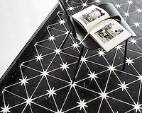 Orion, a waterjet stone mosaic, shown in honed Nero Marquina and polished Calacatta, is part of the Trove Collection for New Ravenna.