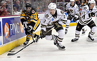 HERSHEY, PA - NOVEMBER 28: Hershey Bears defenseman Tyler Lewington (2) skates the puck from behind the net while Wilkes-Barre/Scranton Penguins left wing Sam Miletic (37) forechecks during the Wilkes-Barre/Scranton Penguins at Hershey Bears on November 28, 2018 at the Giant Center in Hershey, PA. (Photo by Randy Litzinger/Icon Sportswire)