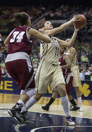 November 18, 2012:  Notre Dame forward Natalie Achonwa (11) goes up for a shot as Massachusetts forward Aisha Rodney (34) defends during NCAA Women's Basketball game action between the Notre Dame Fighting Irish and the Massachusetts Minutewomen at Purcell Pavilion at the Joyce Center in South Bend, Indiana.  Notre Dame defeated Massachusetts 94-50.