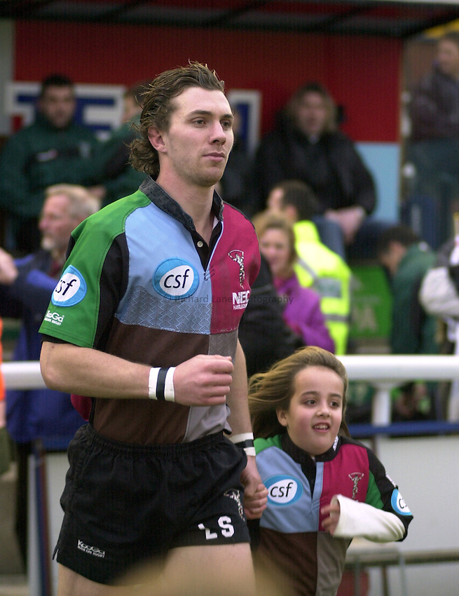 Photo. Peter Spurrier.Parker Pen Challenge Cup 17/01/2004 Harlequins v Montauban.Harlequins Luke Sherriff [capt.] [runs out with the mascot for the day] with the team out for the game against Montauban.