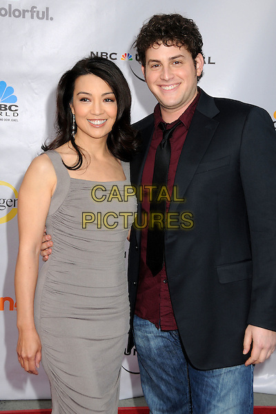 """MING-NA & DAVID BLUE.The Cable Show 2010 """"An Evening with NBC Universal"""" held at Universal Studios Hollywood, Universal City, California, USA..May 12th, 2010.half 3/4 length grey gray dress ruched sleeveless black jeans denim black jacket tie red maroon shirt.CAP/ADM/BP.©Byron Purvis/AdMedia/Capital Pictures."""