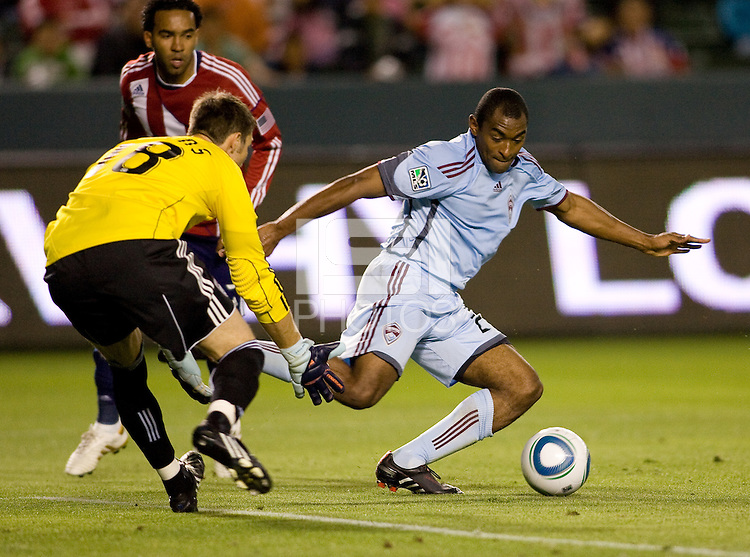Newly signed Marvell Wynne clears a ball out of the box as team mate keeper Matt Pickens moves in. The Colorado Rapids defeated the Chivas USA 1-0 at Home Depot Center stadium in Carson, California on Friday evening March 26, 2010.  .
