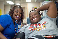 Mississippi Blood Services employee Tammy Addison poses for a picture with donor Taras Woodson, a freshman biological sciences major from Columbus, during a blood drive on the MSU campus. The blood drive will continue every day this week [Sept. 19-23] from 10 a.m. until 6 p.m. in the Mississippi Blood Services vehicle, located in front of the Colvard Student Union on Lee Boulevard. <br />