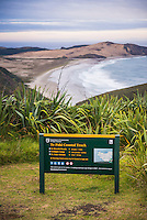 Te Paki Coastal Track sign, with Te Werahi Beach behind, Cape Reinga, New Zealand