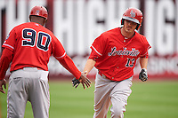 Louisville Bats left fielder Steve Selsky (13) congratulated by manager Delino DeShields (90) after hitting a home run during a game against the Buffalo Bisons on June 23, 2016 at Coca-Cola Field in Buffalo, New York.  Buffalo defeated Louisville 9-6.  (Mike Janes/Four Seam Images)