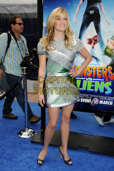 """REESE WITHERSPOON.""""Monsters vs. Aliens"""" Los Angeles Premiere held at the Universal City Walk Gibson Amphitheater, Universal City, California, USA..March 22nd, 2009.full length dress green hand on hip yellow heels shoes open toe grey gray silver .CAP/ADM/BP.©Byron Purvis/AdMedia/Capital Pictures."""