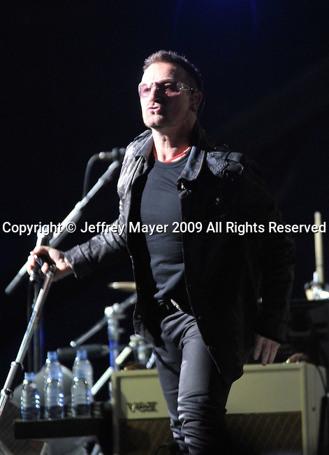 PASADENA, CA. - October 25: Bono and Larry Mullen, Jr. of U2 perform in concert during their 360º Tour at the Rose Bowl on October 25, 2009 in Pasadena, California.