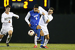 25 October 2013: Duke's Sean Davis (6) is challenge by Wake Forest's Ross Tomaselli (right) as Wake Forest's Ian Harkes (left) chases the play. The Duke University Blue Devils hosted the Wake Forest University Demon Deacons at Koskinen Stadium in Durham, NC in a 2013 NCAA Division I Men's Soccer match. The game ended in a 2-2 tie after two overtimes.