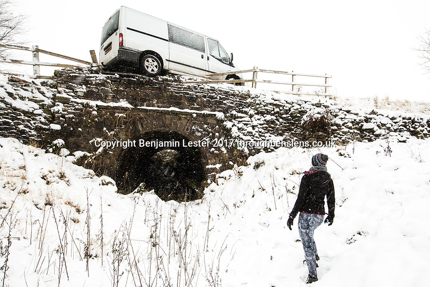 10/12/17<br /> <br /> A walker investigates a van teetering on the edge of a bridge after sliding off the road in the Goyt Valley, near Whaley Bridge in the Derbyshire Peak District. <br />   <br /> All Rights Reserved F Stop Press Ltd. +44 (0)1335 344240 +44 (0)7765 242650  www.fstoppress.com