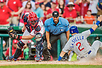 29 June 2017: Washington Nationals catcher Matt Wieters is late with the tag on a sliding Tommy La Stella in the 9th inning of play against the Chicago Cubs as home plate umpire Chad Fairchild looks closely at the outcome at Nationals Park in Washington, DC. The Cubs rallied against the Nationals to win 5-4 and split their 4-game series. Mandatory Credit: Ed Wolfstein Photo *** RAW (NEF) Image File Available ***