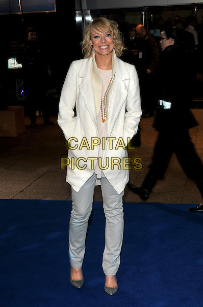 "LIZ McCLARNON .Arrivals - World Premiere of ""Avatar"",  Odeon Leicester Square, London, England, UK, December 10th, 2009..full length white coat jacket jeans grey gray hands in pockets shoes cream .CAP/PL.©Phil Loftus/Capital Pictures."