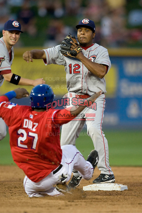 Secondbaseman Anderson Hernandez #12 of the Oklahoma City RedHawks turns a double play against the Round Rock Express on April 26, 2011 at the Dell Diamond in Round Rock, Texas. (Photo by Andrew Woolley / Four Seam Images)