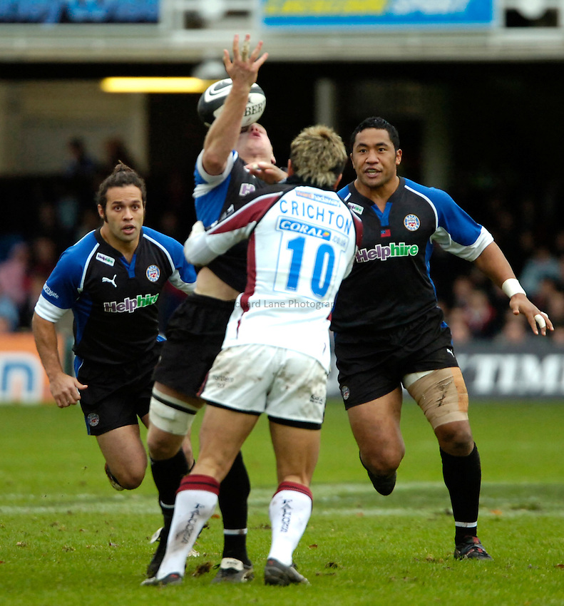 Photo: Ed Godden..Bath Rugby v Newcastle Falcons. Guinness Premiership. 25/11/2006. Bath's James Scaysbrook (centre) loses the ball after colliding with Loki Crichton (no. 10).