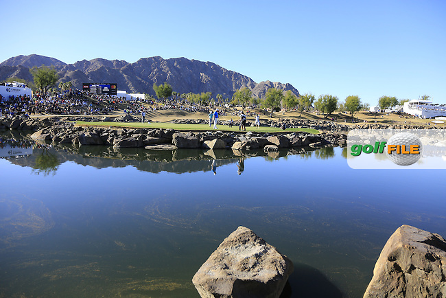 The 17th island green during Saturday's Round 3 of the 2017 CareerBuilder Challenge held at PGA West, La Quinta, Palm Springs, California, USA.<br /> 21st January 2017.<br /> Picture: Eoin Clarke | Golffile<br /> <br /> <br /> All photos usage must carry mandatory copyright credit (&copy; Golffile | Eoin Clarke)