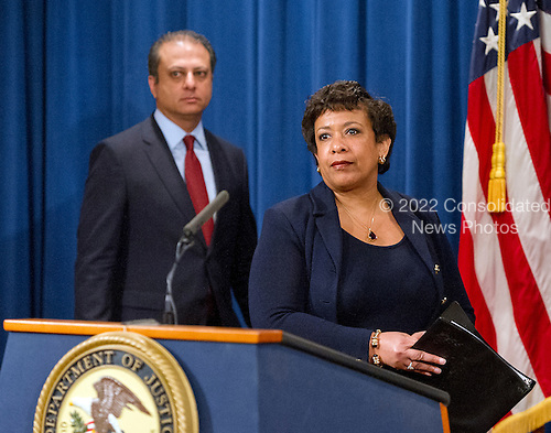 United States Attorney General Loretta E. Lynch, right, and US Attorney Preet Bharara, left, of the Southern District of New York arrive to hold a press conference at the Department of Justice in Washington, DC on Thursday, March 24, 2016.  They announced criminal charges against seven individuals working on behalf of the Iranian government for conducting cyber attacks against the US financial sector and the Bowman Dam in Rye, NY.<br /> Credit: Ron Sachs / CNP<br /> (RESTRICTION: NO New York or New Jersey Newspapers or newspapers within a 75 mile radius of New York City)