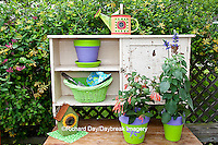 63821-203.11 Potting bench with containers and flowers in spring, Marion Co. IL