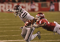 NWA Democrat-Gazette/MICHAEL WOODS • Mississippi State receiver Fred Ross shakes Arkansas defender Kevin Richardson II to score a touchdown in the 2nd quarter of Saturday nights game at Razorback Stadium November 21, 2015.