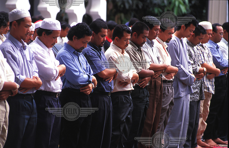 Civil servants and other officer workers attend midday prayers at Masjid Jamie in Kuala Lumpur.  Credit: Chris Stowers.