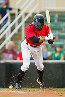 Kannapolis Intimidators center fielder Jacob May (20) gets hit in the right foot by a pitch during the South Atlantic League game against the Greensboro Grasshoppers at CMC-Northeast Stadium on July 13, 2013 in Kannapolis, North Carolina.  The Intimidators wore throwback jerseys of the Piedmont Boll Weevils, who played in Kannapolis from 1996-2000.   (Brian Westerholt/Four Seam Images)