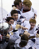 Jack Campbell (USA - 1), Mike Lee (USA - 30), Kyle Palmieri (USA - 23), Jerry D'Amigo (USA - 29), Jason Zucker (USA - 16), Philip McRae (USA - 9), Tyler Johnson (USA - 10), Dave Warsofsky (USA - 5) - Team USA celebrates after defeating Team Canada 6-5 (OT) to win the gold medal in the 2010 World Juniors tournament on Tuesday, January 5, 2010, at the Credit Union Centre in Saskatoon, Saskatchewan.